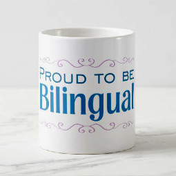 "Coffee mug with the words ""Proud to be bilingual"" printed on the side"